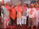 Amit Jani's parents, Deepti Jani and Suresh Jani celebrating Modi's victory with other members of of BJP